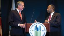 New York City Mayor Bill de Blasio and Ben Carson, Secretary of Housing and Urban Development (HUD), take questions after signing a ceremonial agreement between the federal government and the City of New York intended to correct mismanagement of the New York City Housing Authority (NYCHA), during a press conference at the Jacob Javits Federal Building, January 31, 2019 in New York City. (Photo by Drew Angerer/Getty Images)