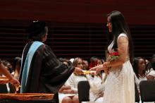 Aylin Vazquez De La Cruz receiving her high school diploma at graduation. (Photo: Samantha Madera/AL DÍA News)