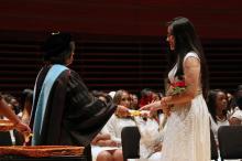 Aylin Vazquez De La Cruz receiving her high school diploma at graduation. (Photo: Samantha Madera/AL DÍA News)