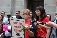 María del Carmen Díaz (left), a domestic worker and leader in the Pennsylvania Domestic Workers Alliance, speaks on June 20 about the legislation introduced to City Council which extends a range of labor rights and protections to housekeepers, nannies, caretakers, and others in the domestic worker industry. Nicole Kligerman (right), director of the PDWA, stands by, providing translation from Spanish to English. Photo: Emily Neil / AL DÍA News