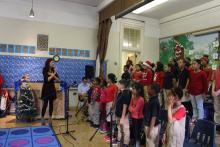 "Mandy Gonzalez, star of ""Hamilton,"" ""In the Heights,"" and other Broadway productions, visited Isaac Sheppard School in Kensington on Dec. 7. Photo: Emily Neil / AL DÍA News"