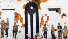 The black and white flag is the work of a collective of pro-independence artists who in 2016 were protesting the economic austerity measures imposed by the Obama administration. Via Univision.