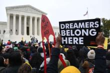 Immigration rights activists rally outside the U.S. Supreme Court in 2019. A federal judge has dealt a fresh blow to an immigration program protecting undocumented immigrants brought to the country as children, ruling it unlawful and blocking the enrollment of new applicants.Saul Loeb/AFP / Getty Images 2019