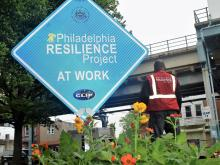 A sign announcing the work of the Philadelphia Resilience Project in Harrowgate. They can be seen across Kensington and Fairhill. Photo: Philadelphia Mayor's Office