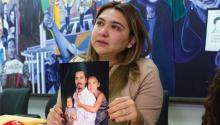 Ana Castillo shows a photo of her husband Marlon Castillo with two of her daughters during a press conference in Los Angeles, California. Marlon Castillo, 46, is one of the last undocumented immigrants arrested while doing paperwork to legalize his immigration status. EFE