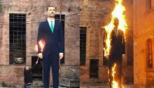 Los artistas Santiago Serra y Eugenio Merino quemando la escultura hiperrealista de Felipe VI.Photo: YouTube.