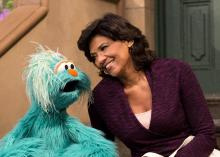 Rosita, the bilingual Mexican Muppet, and her human Puerto Rican friend, Maria Rodriguez. All rights reserved to The Jim Henson Company/Muppets Incorporated.