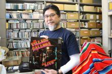 Shin Miyata poses in his office west of Tokyo, Japan, with a vinyl record of The Village Callers, one of the most famous East Los Angeles bands of the 1960s. EFE