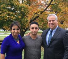 Cristian Ochoa (center) was awarded one of four $1500 scholarships this year from the Latino Luncheon of Chester County group, including co-organizers Nelly Jimenez-Arevalo (left) and Leonard Rivera (right). John N. McGuire / AL DÍA News