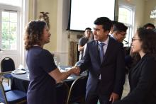 Maria Samaniego, opening keynote for the 2019 Caminos al Futuro & program manager at the Aspen Institute Latinos and Society Program, shakes hands with scholars. Photo Courtesy of Marcelo Gonzales Montoya. program manager at the Aspen Institute's Latinos and Society Program