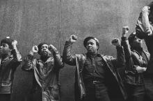 View of a line of Black Panther Party members as they demonstrate, fists raised, outside the New York County Criminal Court (at 100 Court Street), New York, New York, April 11, 1969. Photo:David Fenton/Getty Images.