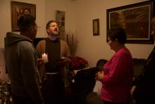 Brother Andrew McCarty leads celebrants in a closing prayer at a posada on Dec. 19. Photo: Emily Neil / AL DÍA News