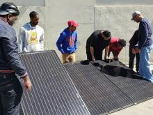 Working with solar panels at the workforce development program in 2019. Photo Courtesy of PECO.