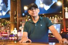 Sal Nunez, the Dominican owner of the Latin Caribbean restaurant, Buccann, in Oxford Circle. Photo Credit: Taylor Farnsworth/Department of Commerce