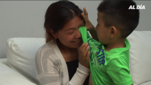 Guatemalan mom and son share an emotional moment while sharing their story with AL DÍA News on June 30, 2019. (Photo: Sandra Rodriguez/Ana Aguilera)