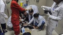 Photo courtesy of the Syrian Arab news agency (SANA) shows that wounded Syrians receive first aid in an emergency room at the Al Mouwasat Hospital, Damascus, Syria, on April 7, 2018. EFE