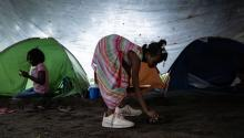 TAPACHULA, MEXICO - JUNE 18: A young girl plays next to a tent where she is temporarily living on June 18, 2019 in Tapachula, Mexico. The Mexican government launched a deployment of the National Guard seeking to control the flux of migrants crossing from Guatemala to Mexico, as part of an agreement with the US government to avoid tariffs on all Mexican exports. (Photo by Toya Sarno Jordan/Getty Images)