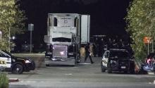 Officials investigate a truck that was found to contain 38 suspected illegal immigrants in San Antonio, Texas, USA, 23 July 2017. EPA/DARREN ABATE