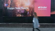 BERLIN, GERMANY - FEBRUARY 18: A young woman walks past a billboard advertisement for the dating app Tinder on February 18, 2019, in Berlin, Germany. Tinder has emerged as one of the most popular dating apps. (Photo by Sean Gallup/Getty Images)
