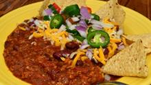 In the US, the answers prove Trump's wall not culinary. Photo: A dish of chili with garnishes and tortilla chips. Wikimedia/Commons