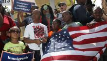 MIAMI, FL - MAY 13: People protest the possibility that the Trump administration may overturn the Temporary Protected Status for Haitians in front of the U.S. Citizenship and Immigration Services office on May 13, 2017, in Miami, Florida. (Photo by Joe Raedle/Getty Images)