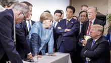 Icónica foto de una discusión entre los integrantes del Grupo de los 7 (G7) y el presidente estadounidense Donald Trump. Jesco Denzel/German Federal Government via AP