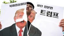 "A protester breaks a poster with the photograph of President Donald J. Trump, who canceled the summit he was to hold on June 12 with the North Korean leader, Kim Jong-un, although he opened the door to reprogramming it and threatened Korea North with a military response if it acts ""recklessly"". EFE"