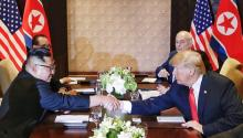 The president of the United States, Donald J. Trump (R), and the North Korean leader, Kim Jong-un (L), shake hands on the table during their historic summit on Tuesday, June 12, 2018, at the hotel Capella on the island of Sentosa (Singapore). EFE / KEVIN LIM / THE STRAITS TIMES / SPH / ONLY EDITORIAL