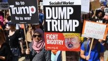 "Demonstrators hold signs with messages against the president of the United States, Donald J. Trump, in London, United Kingdom on July 13, 2018. Trump's visit to the United Kingdom raises mass protests in rejection of its policy on matters such as immigration and environment, and comments that his opponents describe as ""racist"" and ""misogynistic"". EFE / Andy Rain"