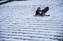Kids and adults grab their sleds or snowboards and race down the steps of the Art Museum. Photo: Peter Fitzpatrick/ AL DIA News
