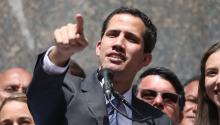The leader of the Parliament and president in charge of Venezuela, Juan Guaidó (C), speaks this Friday during his first public appearance since his oath before thousands of people, in a plaza in the east of Caracas (Venezuela). EFE/Miguel Gutiérrez