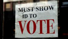 An ad warns citizens that they must present an ID to be able to vote. Photo: Todd Wiseman.