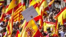 "A poster with ''The streets are for everyone '' runs the demonstration called by Societat Civil Catalana today in Barcelona in defense of the unity of Spain under the motto ""Stop it! Let's recover common sense"" in which thousands of people have participated EFE / Quique García"