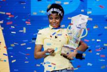 Zaila Avant-garde holds her trophy after winning the 2021 Scripps National Spelling Bee. Photo Credit: Joe Skipper / REUTERS.